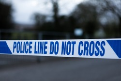 Police barrier tape in the UK at the scene of a crime. Police line do not cross