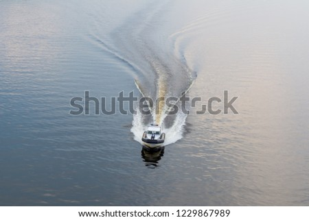 Police boat on the river in the evening