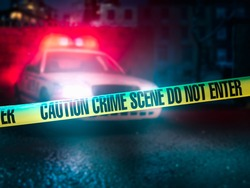 police car at a crime scene with police tape / high contrast image