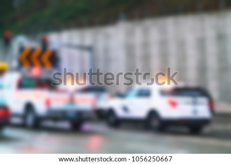 police car on the road for traffic service.  -blurred picture.