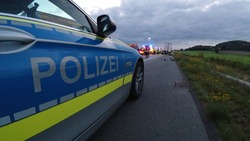 police car stand on German highway near an accident
