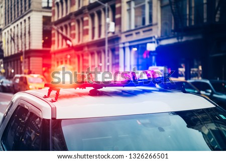 Police car with alarm and signal light flashes on the roof rush emergency call in New York City #1326266501