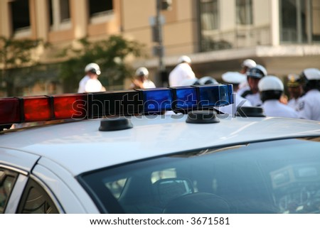 police cruiser with officers in the background