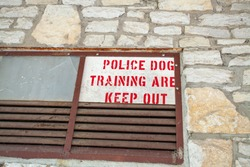 Police Dog training sign in a window of a building in a local park