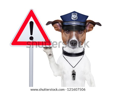 police dog with a street warning sign