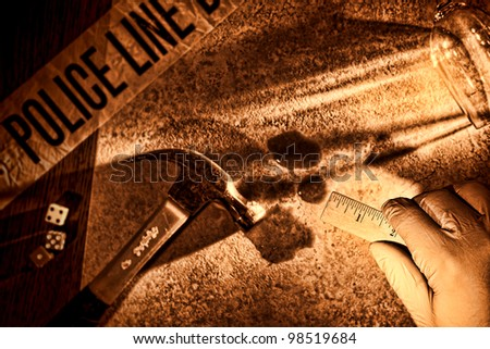 Police forensic investigator with glove on hand holding a technician measuring ruler at CSI gruesome murder crime scene with hammer weapon and victim blood evidence during a criminal law investigation