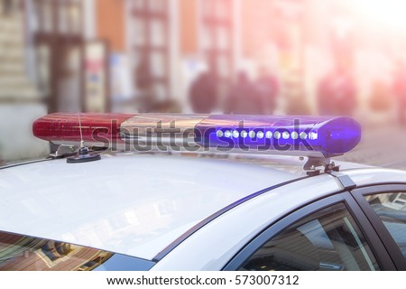 police light and siren on the car in the street