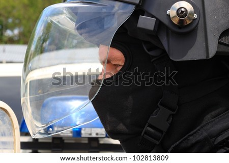 police officer in a protective helmet and visor, preparation for the demonstration