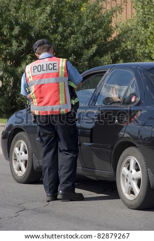 Police officer issuing speeding ticket