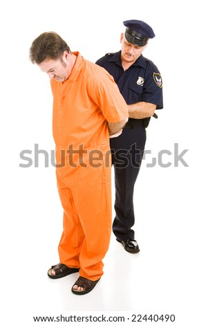 Police officer placing handcuffs on prisoner in orange prison jumpsuit.  Full body isolated on white.