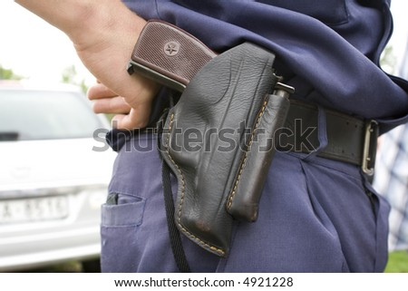 "Police officer`s holster with ""PM"" gun."