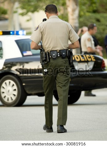Police officer walking toward his car