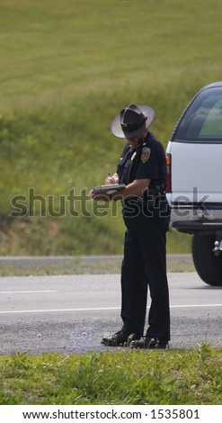 photo of police officer writing a ticket