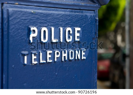Police public telephone blue box. To be used in case of emergency. - stock photo