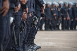 Police riot used shields and batons to practice outdoors.