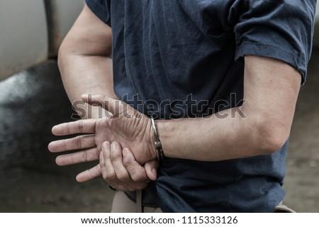 Police steel handcuffs,Police arrested,Police arrested the culprit, the police,the culprit,Arrest the culprit, criminal,Selective focus,noise.