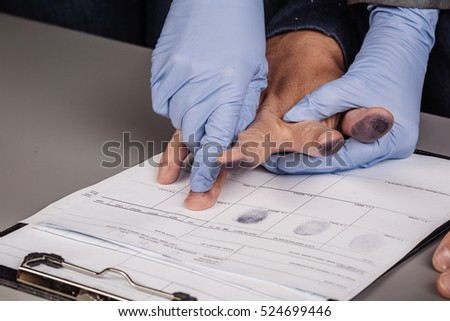 police takes fingerprints of a criminal. law concept.