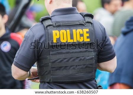 Police uniform on the back of policeman