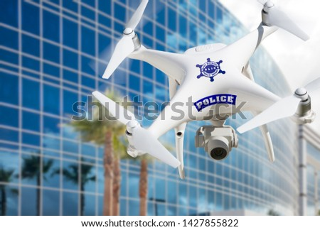 Police Unmanned Aircraft System, (UAS) Drone Flying Near City Highrise Building.