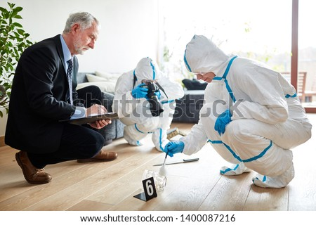 Police with forensics at forensics after raid at the scene Stock photo ©