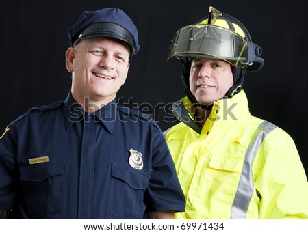 Policeman and fireman both photographed against a black background.