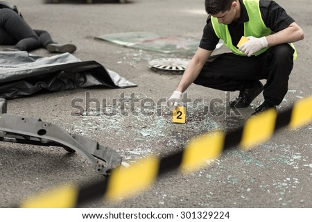 Policeman during investigation at road accident area