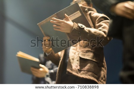 Policeman is reviewing files and documents
