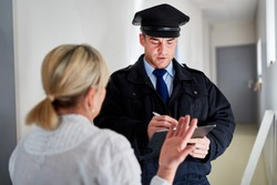Policeman makes witness interview after burglary and talks with witnesses
