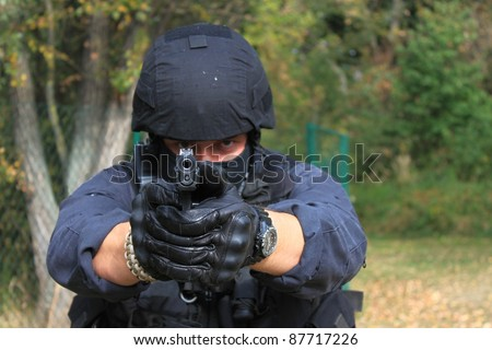 policeman pointing weapons at the camera, detail