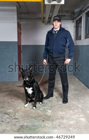 Policeman posing with his dog in a basement - crime scene