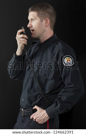 Policeman talking with his CB radio