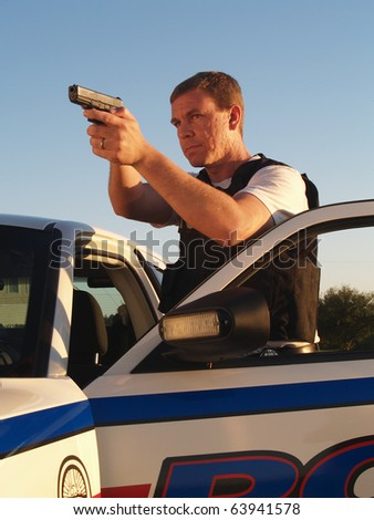 Policeman with Weapon Drawn