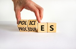 Policies vs procedures symbol. Businessman turns wooden cubes, changes the word 'procedures' to 'policies'. Beautiful white table, white background, copy space. Business, policies, procedures concept.