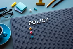 Policy text on desk office.business management and strategy of organization concepts.vision to success