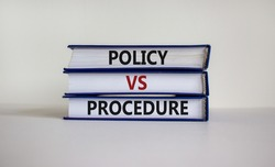 Policy vs procedure symbol. Books with words 'Policy vs procedure' on beautiful white table, white background. Business and policy vs procedure concept, copy space.