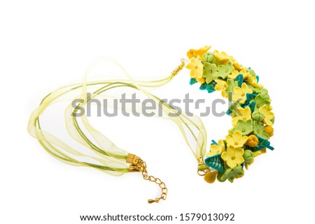 Polimer clay necklace with floral ornament isolated on white background. Female accessories, decorative ornaments and jewelry. Fashion and style concept. Zdjęcia stock ©