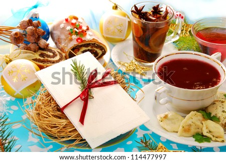 polish christmas eve table with white wafer on plate with hay and traditional dishes