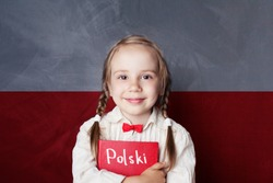 Polish concept with little girl student with book against the Polish flag background. Learn language