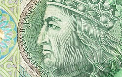 Polish currency, PLN, 100 zł, one hundred zloty bill macro, extreme closeup detail Władysław II Jagiełło face on a bank note top view, from above, top view, banknote up close, Polish money