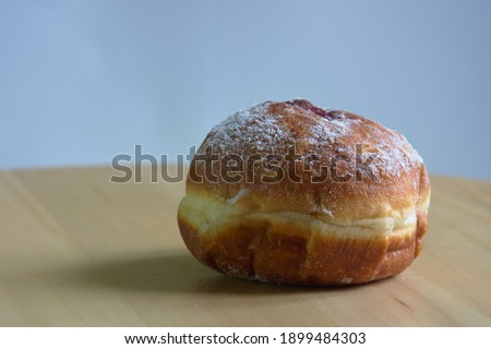 Polish donuts with powdered sugar on gray and wooden background. Fat Thursday  Zdjęcia stock ©