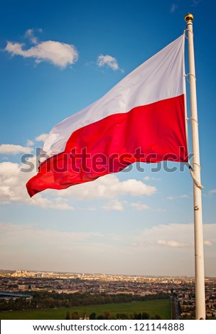 Polish flag against the sky