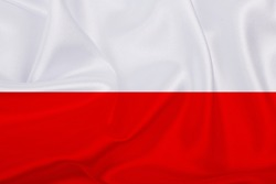 Polish flag - fabric texture flag of Poland. Flag of Poland waving in the wind. Close up of Poland flag waving in the wind, official 8x5 aspect ratio.