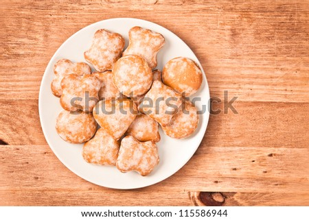 Polish ginger cookies on a plate on wooden background