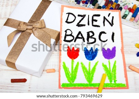 Polish Grandmother's Day card with words: Grandmother's Day. Colorful hand drawing, crayons and gift box. Zdjęcia stock ©