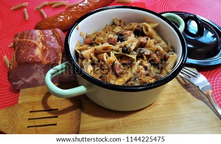 Polish (lazanki) dish: Strongly seared cubes of smoked bacon,polish style sausage,onion - then cooked with sauerkraut,mushrooms,allspice,bay leaf,whole black pepper,dill,cumin,whole wheat penne pasta. #1144225475