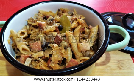 Polish (lazanki) dish: Strongly seared cubes of smoked bacon,polish style sausage,onion - then cooked with sauerkraut,mushrooms,allspice,bay leaf,whole black pepper,dill,cumin,whole wheat penne pasta. #1144233443