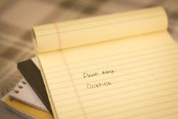 Polish; Learning New Language Writing Greetings on the Notebook (Translation; Good Morning)