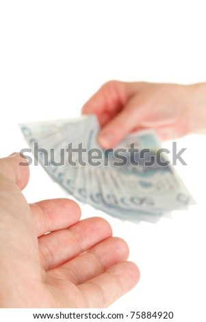Polish money isolated on white in hand