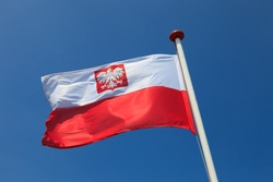 Polish national flag in the sky.