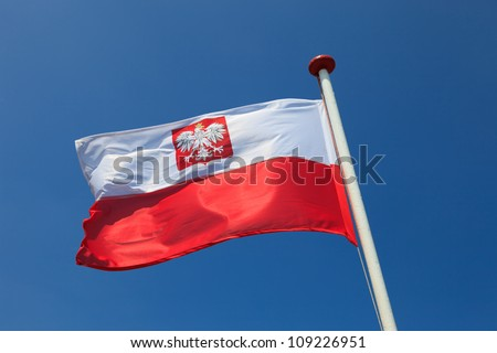Polish national flag in the sky.